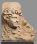 Relief with a head of Bacchante
